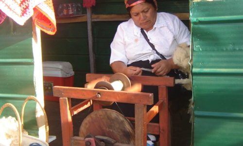 Woman spinning wool at Angelmo Market Puerto Montt Chile